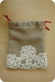 Such a great idea for gift bag-fabric glue and doilies, dye/spray paint the doilies to match a color scheme