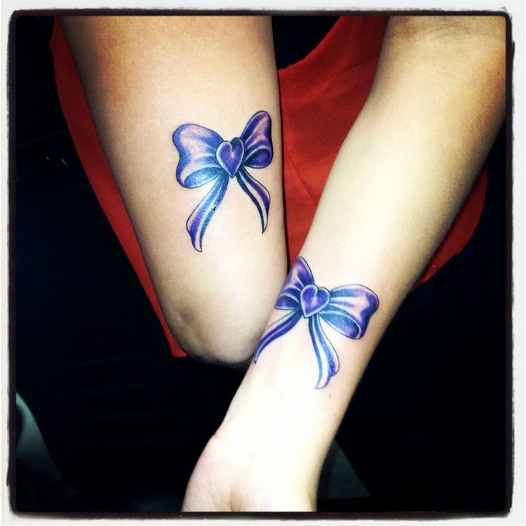 Best friends tattoo. such beautiful color in these tats!