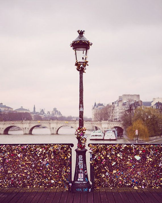The locks on the Pont des Arts were cut off by the government. However, romance trumps politics in the city of love.    TITLE: Love Locks