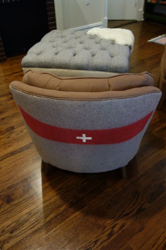 We love this armchair upholstered with a vintage Swiss army blanket
