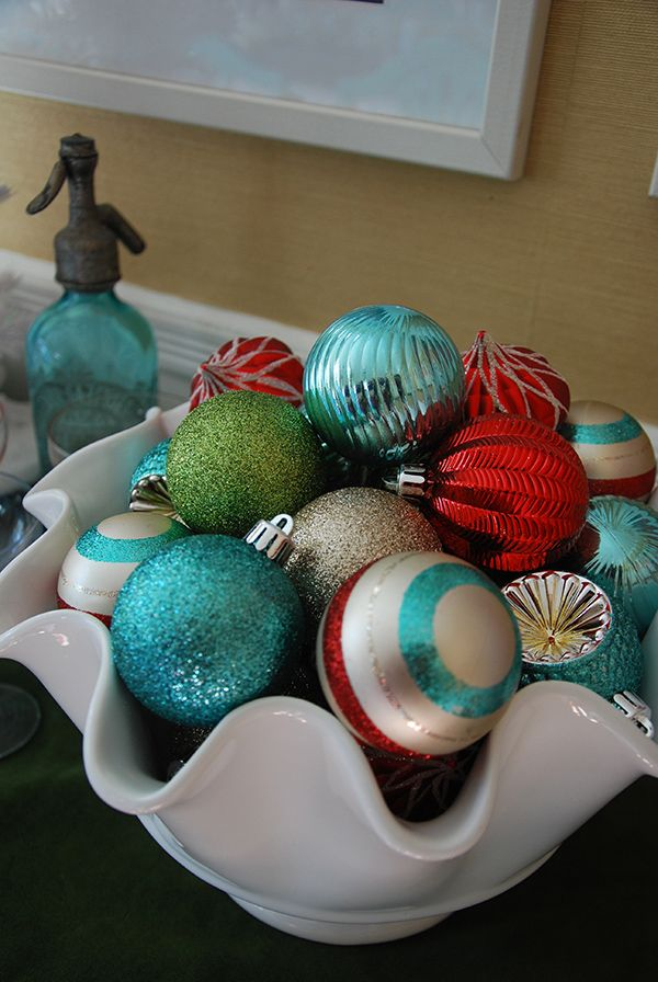 Dining Room Christmas Decorations in Teal, Red and Mint Green. Designer Camila Pavone created a bright and lively holiday look for her dining room using ornaments from the Frosted Traditions Collection.