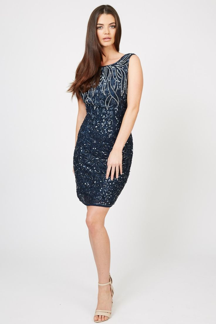 TFNC Party Dress<br /> <br /> - Shift style<br /> - Crew neckline<br /> - Heavily embellished <br /> - Exposed zip to reverse<br /> <br /> Care: 100% Polyester. Hand Wash Only