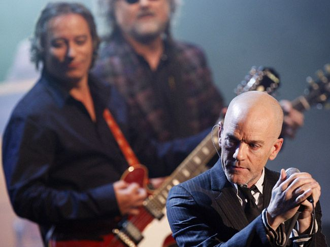 How did they get their name? R.E.M - vocalist Michael Stipe drew the acronym (that refers to the rapid eye movement phase of sleep) randomly out of the dictionary. Picture: AFPMichael Stipe, Eye Movement, Movement Phase, Vocalist Michael, Stipe Drew, Rapid Eye, Odd Spots