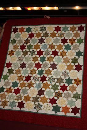 Met de hand gemaakte quilt van restjes.