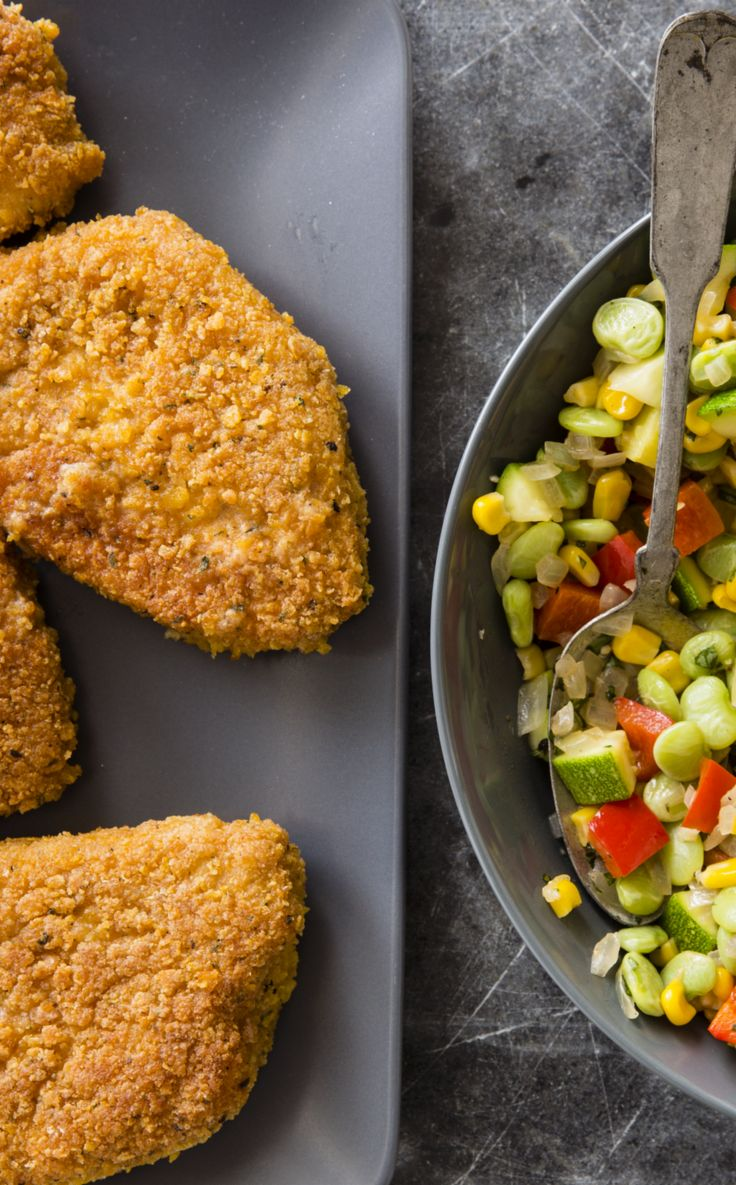 Cast Iron Crispy Pan-Fried Pork Chops with Succotash - When they're done right, pan-fried pork chops feature a crisp exterior and moist, juicy meat. Pan frying in a cast-iron skillet helps maintain a constant frying temperature for even cooking.  Succotash, the classic American vegetable blend of lima beans, corn, and bell pepper, was the perfect complement for our pork chops. Zucchini added an extra layer of freshness.