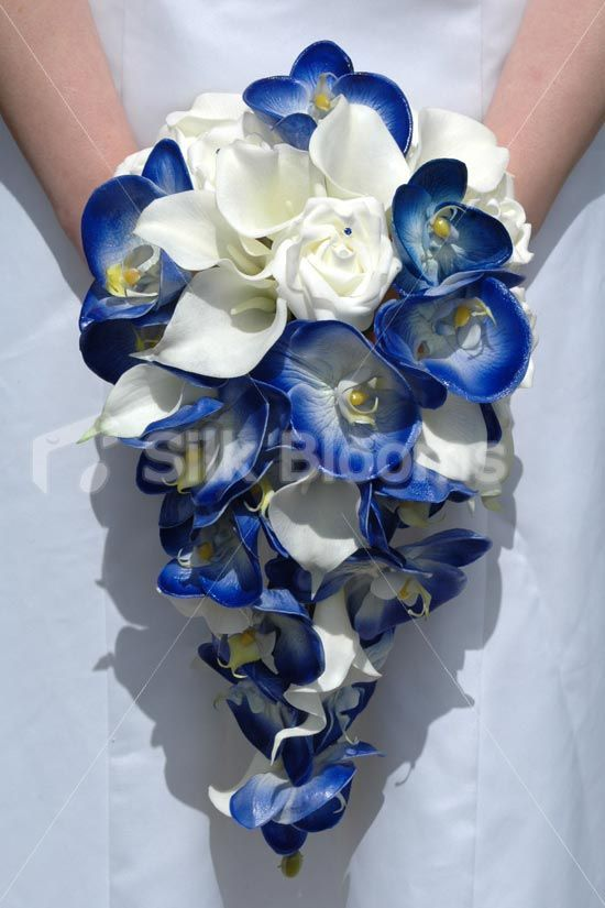 Stunning, modern royal blue and ivory bridal wedding flowers.	 Modern, vibrant blue and ivory cascading brides bouquet.	 Elegant, contemporary artificial bridal flowers from Glasgow. Hand tied with luxury ivory satin ribbon and satin bow. Finished off with blue crystal pins and heart ribbon crystal slider.	 Wonderful mix of roses, orchids and calla lilies - just perfect!