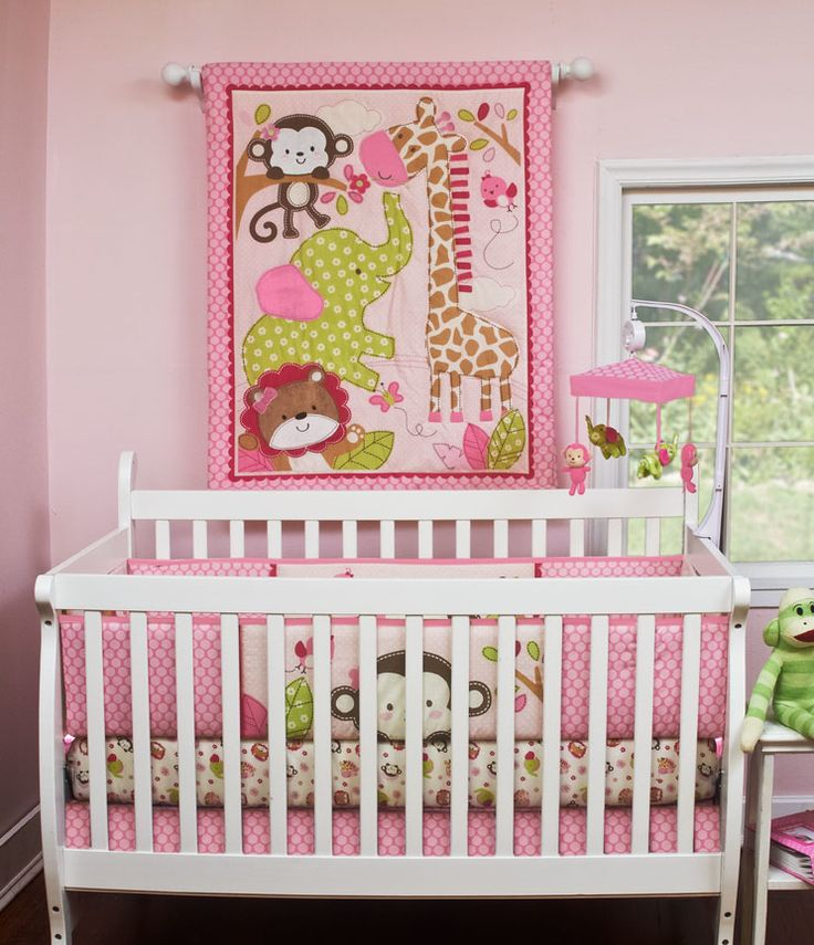 Jungle Joy Crib Bedding  (Girl's Jungle Crib Bedding)  Complete your nursery with this complete   set including a musical mobile. This fun   jungle scene is perfect for your little   queen of the jungle. The quilt features   embroidered and applique highlights.    This set features light pink, dark pink,   green, and touches of white, tan, and   brown.  These loving jungle animals are so   sweet and cuddly for your little girl.