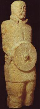 (Celtic/Indo-European torc) Stone statue of a warrior wearing a torc, Castro do Lezenho, Boticas, Portugal 1st c. BC-1st c.AD, Museu Nacional de Arqueologia e Etnologia, Lisbon