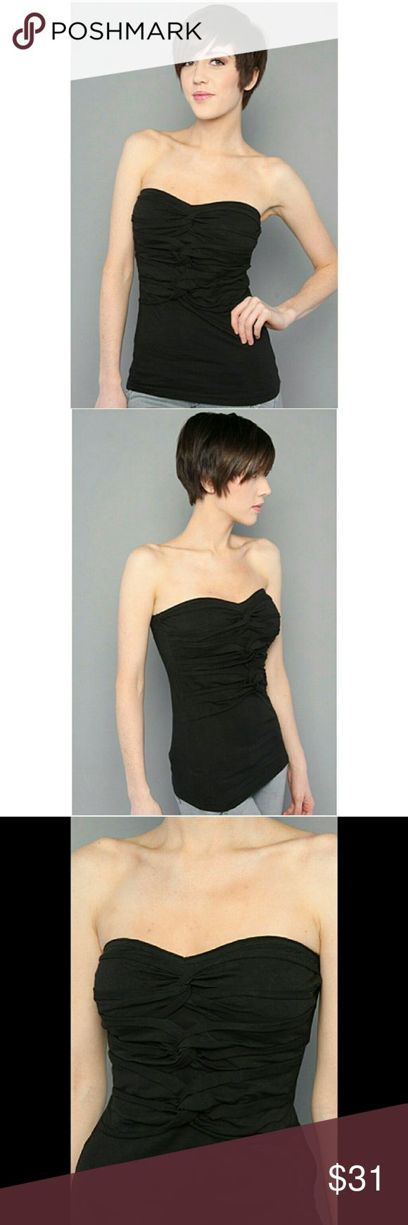 NWT FREE PEOPLE DO THE TWIST BLACK TUBE TOP ??Beautiful top! ****SIZE LARGE ****Purchased from Macy's    ?Sweetheart neckline ? stretch jersey tube top; twisted knots along         center front;  ?elasticized upper back; 95% cotton, 5% spandex.  ??By Free People!    * tags come with :tag was removef by accident, NEVER Worn! Free People Tops Tank Tops