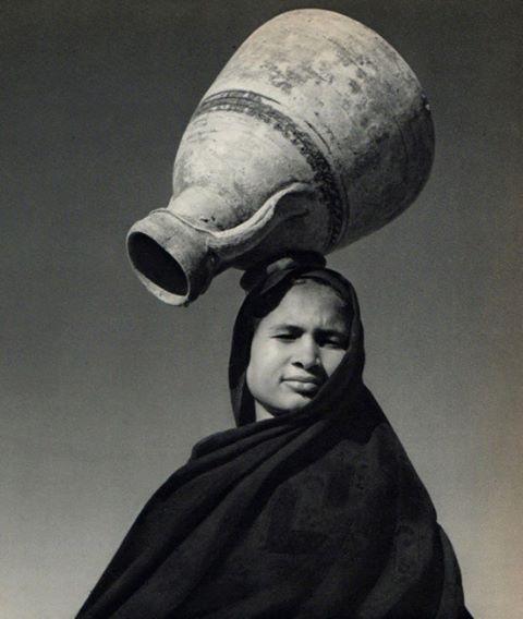 Fellahin woman with empty water vase