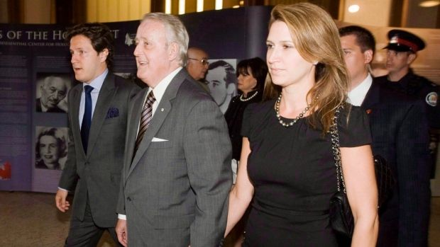 Former prime minister Brian Mulroney arrives for a charity event in Toronto in 2010, with his son Mark, left, and daughter Caroline, right. Caroline Mulroney hasn't rejected the idea of running to replace Patrick Brown as leader of the Ontario PCs. Mark also has been touted as a potential federal Conservative leader some day.