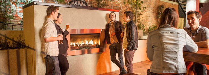 Young people enjoy time around Escea EF5000 outdoor gas fireplace