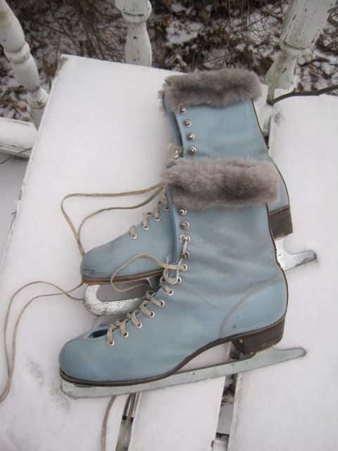 vintage blue ice skates- I had these skates as a young teenager in the early sixties till someone stole them from the park after skating one night. i turned my back and they were gone.