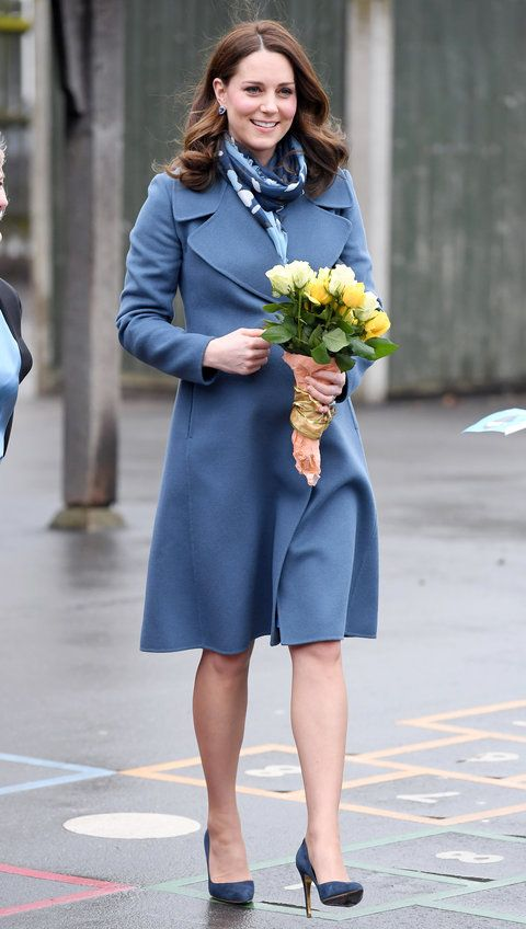 Middleton paid a visit to the Roe Green Junior School to give a poignant speech on children's mental health. The royal looked elegant in a periwinkle Sportmax coat, Seraphine maternity dress ($99; seraphine.com), patterned scarf, and matching suede pumps (shop similar here).