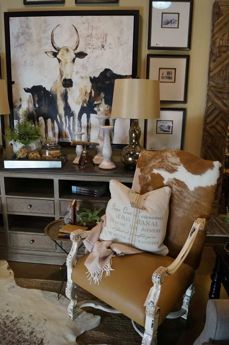 Cowhide and Leather Chair. Rustic Luxe inspired vignette at Fabrics and Furnishings in Conyers, GA.