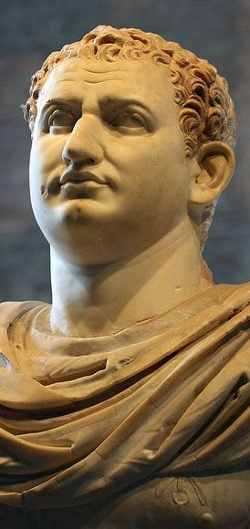 "The Flavian emperor Titus (A.D. 79-81). Found in the so-called ""basilica"" Herculaneum, now in the Naples Museum (photo from the ""Divus Vespanianus"" exhibit, 2009, Curia, Roman Forum). The full portrait depicts the emperor in a chestplate (cuirass) and cloak."