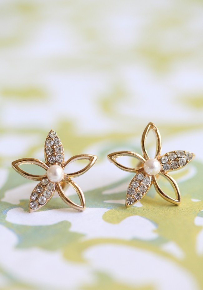 """Starlight Flower Earrings 9.99 at shopruche.com. Simple and elegant, these golden hued floral studs are finished with pearly beads and sparkling rhinestone accents.  0.75"""" wide"""