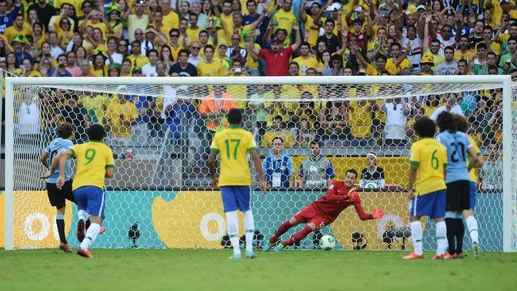 Brazil x Uruguay / 26-jun-13: Julio Cesar saves the penalty kick of Diego Forlan during the Semi Final match. Belo Horizonte, Brazil.