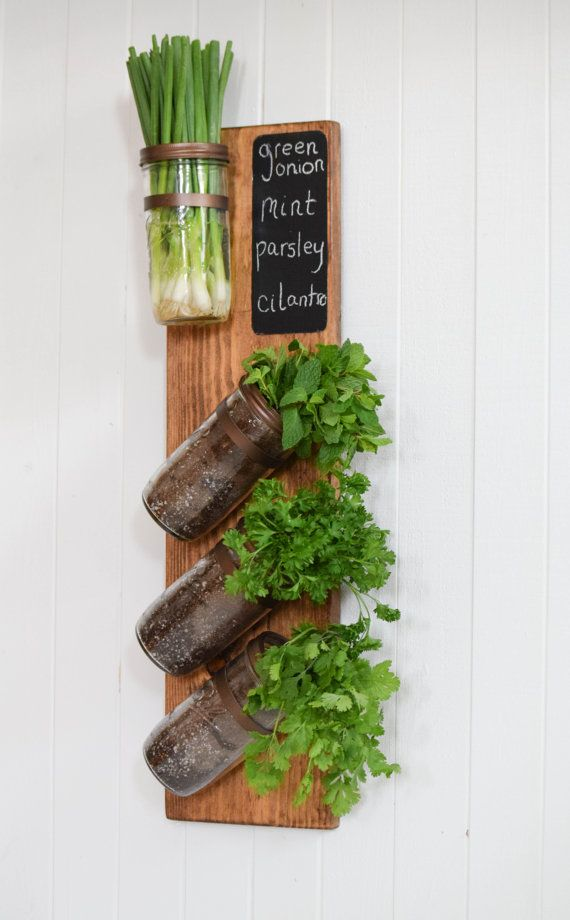 This completely hand-crafted vertical herb garden is perfect for indoor or outdoor gardening. Makes the perfect addition to any kitchen garden to grow fresh, organic herbs to incorporate into cooking. Mason jar easily unscrews from wall mount for painless accessibility to herbs or plants. Easy to hang with routed out key hole mechanisms. Created with solid wood, chestnut stain with 24oz mason jar planters fixed with painted copper fittings.  We handmade and embed all chalkboards into the…