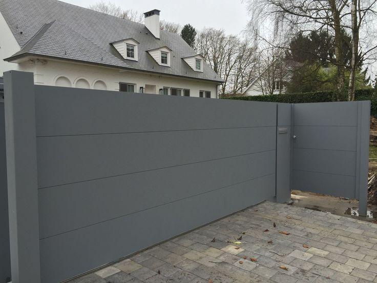 http://www.toriportails.be/realisations/portails/portail-aluminium-coulissant-et-son-portillon