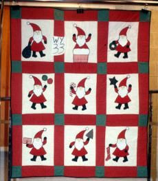 Falandino, Lucy. Santa. 1986. From Michigan State University Museum, Michigan Quilt Project. Published in The Quilt Index, http://www.quiltindex.org/basicdisplay.php?kid=1E-3D-A5B.: