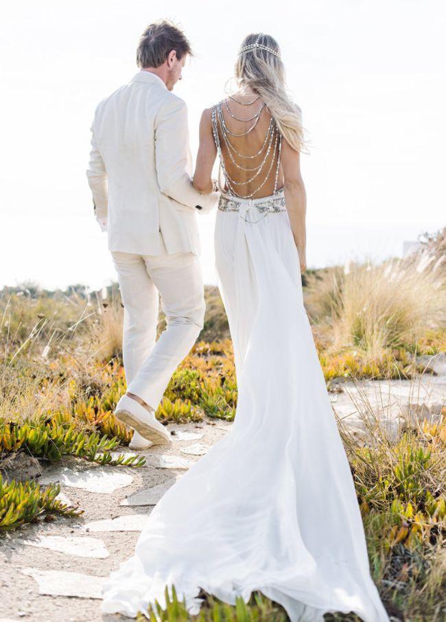 20 Dreamy Beach Wedding Dresses | SouthBound Bride | http://www.southboundbride.com/dreamy-beach-wedding-dresses | Credits: Ana Lui Photography via Style Me Pretty