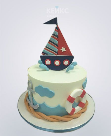 Торт в морском стиле с корабликом и спасательным кругом