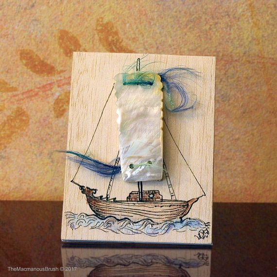 An #inkdrawing of a #ship on #balsawood #card with a #motherofpearl huge sail!