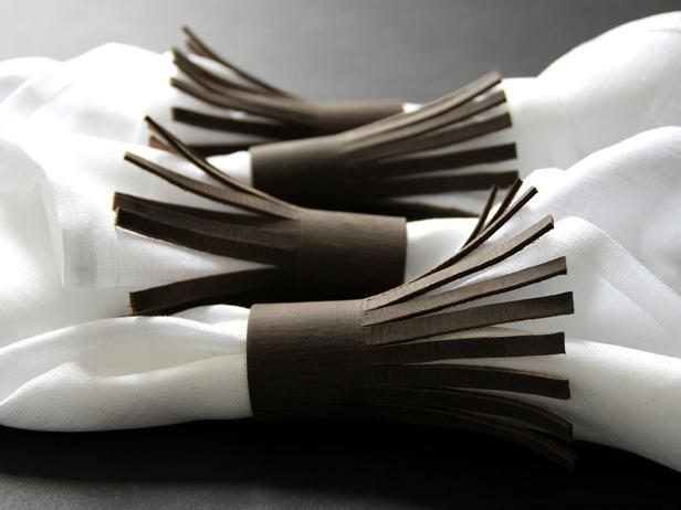 A popular material for fashion, leather also adds a trendy, but still traditional, touch on a Thanksgiving tablescape from DIY Network. Leather Napkin Holders
