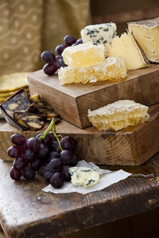 Honeycomb, cheese aged with wine, grapes and throw in a few walnuts...  Food for lovers!