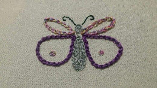 Mariposa punto cadeneta y relleno largo y corto