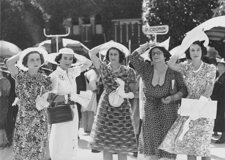 1930s . Ladies trying to keep their hats on at the Brisbane races.