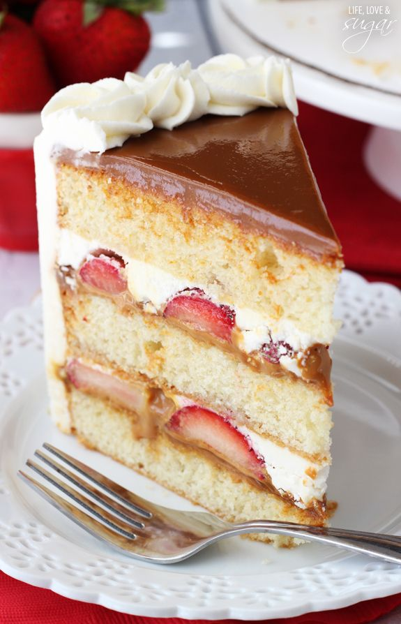 Strawberry Dulce De Leche Cake - layers of moist vanilla cake, dulce de leche, fresh strawberries and vanilla buttercream! A delicious combo...
