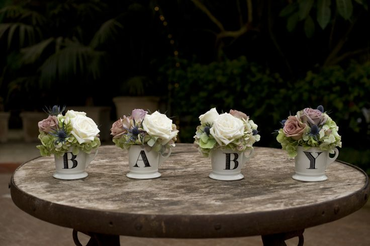 Love the cups with flowers: Gender Neutral Baby Shower Baby Centerpiece