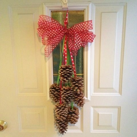 Just pine cones and ribbons and a little hot glue.  My front door never looked better :)