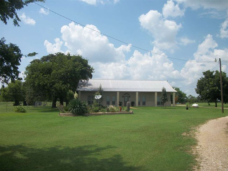 5133 MAZANEC RD, Bellmead, TX 76705 Looking for your piece of the country? This 3BR/2BA is surrounded by 23.892 acres with a pretty tank. Built in 2009, this home is steel framing and offers an open living/dining with windows across the living area overlooking the covered patio and grounds. The kitchen sparkles with granite counter-top, eating area plus a breakfast bar. Isolated master suite with large walk-in closet, garden tub and separate shower. There is also an office.