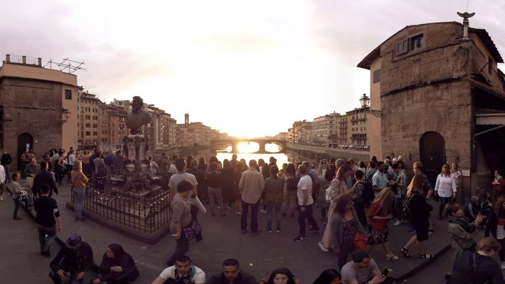 360 video: Sunset View from Vecchio Bridge, Florence, Italy / VR, Virtual reality / Crossing the Arno River, this closed medieval bridge with arches is one of the oldest structures in Florence. The current bridge dates back to 1350 when it was rebuilt after a damaging flood.