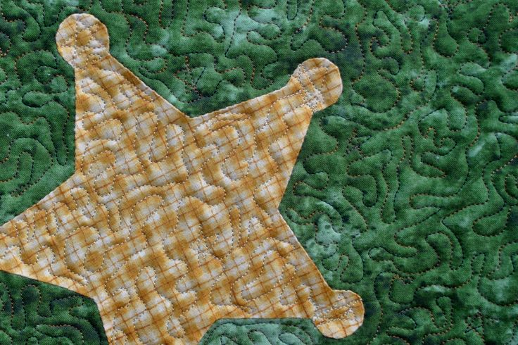 Detail of horse quilt. Hand appliqued. This is one of my first attempts at free motion quilting