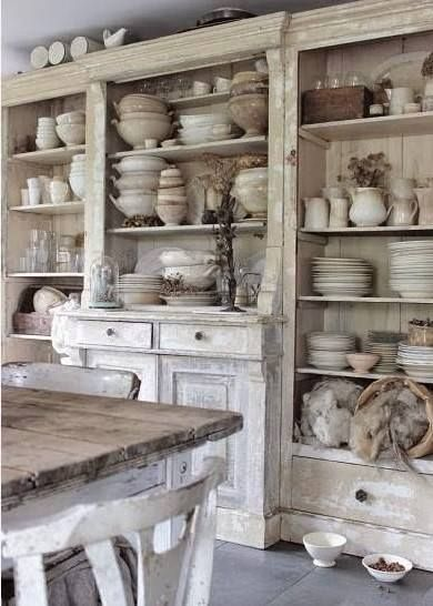 ironstone collection in a large vintage, white cupboard
