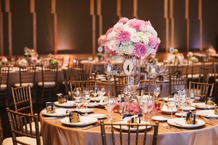 Neutral tables scapes allow for your centerpieces to be the stars of the show! Love the Champagne Lamour full lengths