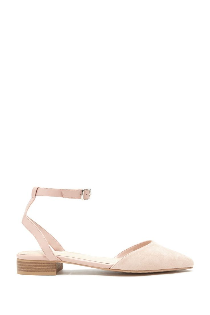 A pair of faux leather sandals with a buckled ankle strap and a faux suede pointed toe.