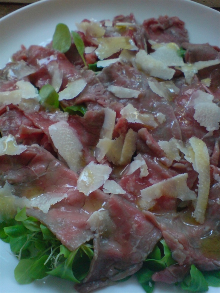 This is my favorite appetizer...Carpaccio is thin raw sliced beef cooked with fresh lemon and rucula, parmesan, capers and maybe truffle or mushrooms.