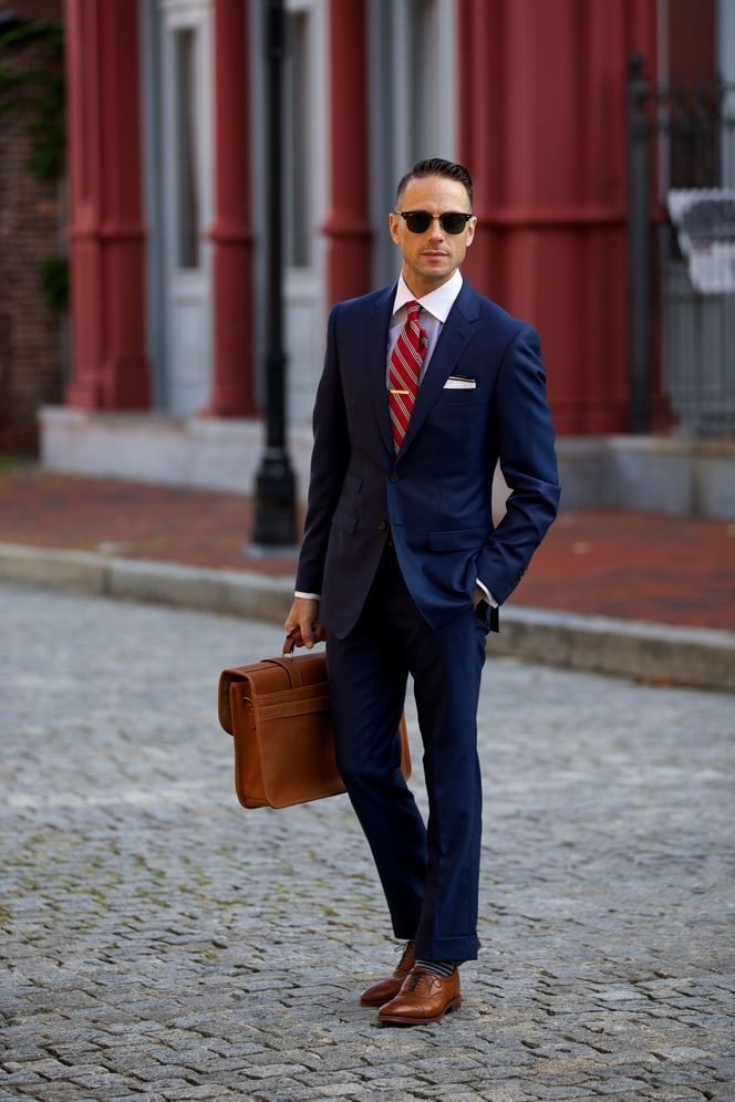 Brown shoes are more relaxed than black; and brown shoes with a navy suit is a classic combination to pull off. It's essentially a fool-proof look, more casual than black but still smart enough to wear to work or other formal occasions.