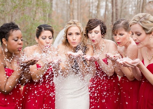 Christmas bridesmaids in red dresses with Eco friendly snow confetti