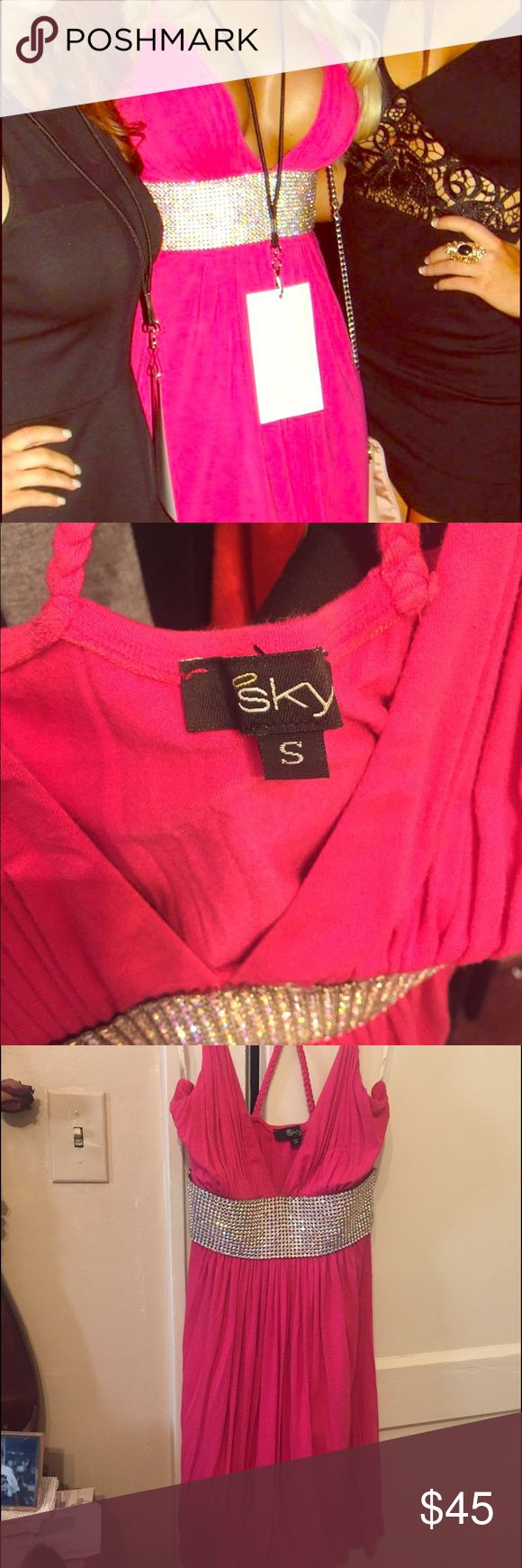 Hot pink mini dress This is a sky hot pink mini dress. With a large band of AB crystals that goes right under your breasts. Super comfortable! almost feels like you're wearing a T-shirt, the back has a Razorback pattern. If you're a blonde this is the total Barbie dress! Sky Dresses Mini