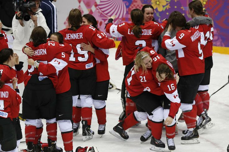 Feb 20, 2014; Sochi, RUSSIA; Team Canada celebrates their 3-2 overtime over USA in the women's ice hockey gold medal game during the Sochi 2014 Olympic Winter Games at Bolshoy Ice Dome. (Winslow Townson-USA TODAY Sports)