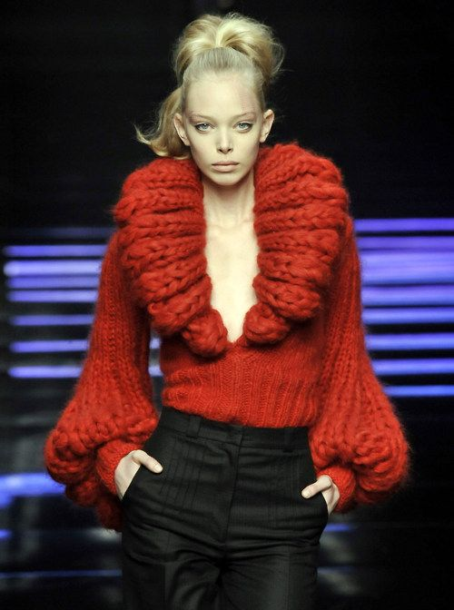 Bold, knit red sweater.  Great color for Valentine's Day.