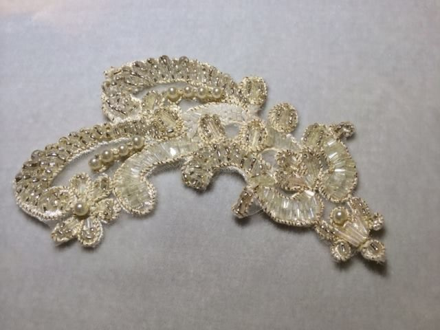 Couture hand beaded lace, adorned with Swarovski crystals and pearls.   #wedding #accessories #beading #tiaras #vintage #jewellery #bride #Swarovski #crystal  www.arynverebride.com