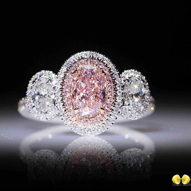 A pink diamond like no other, set in a delicate oval shaped halo with white oval…