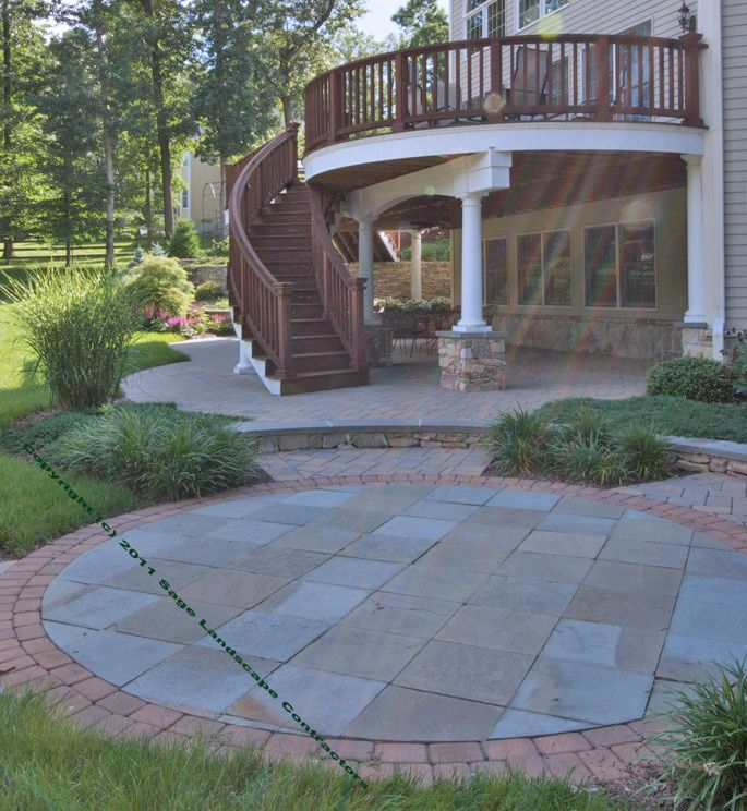 Curved Deck Staircase Complements A Circular Patio With Different Levels Of  Pavers For An Elegant Outdoor